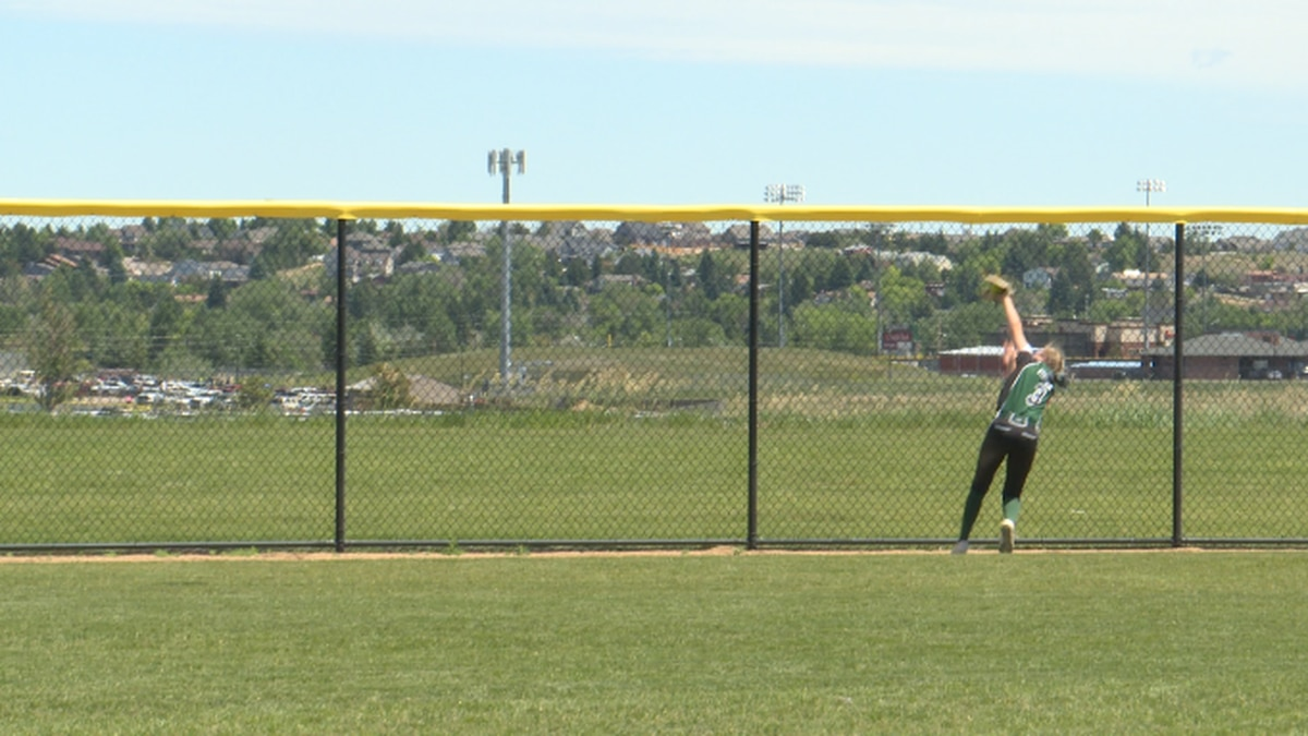 Cheyenne Extreme 18U outfielder, Trista Stehwien, catches the ball at the fence against the...