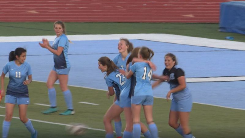 Cheyenne East celebrates around Aryana Booth (#23) after she scored her first career goal...