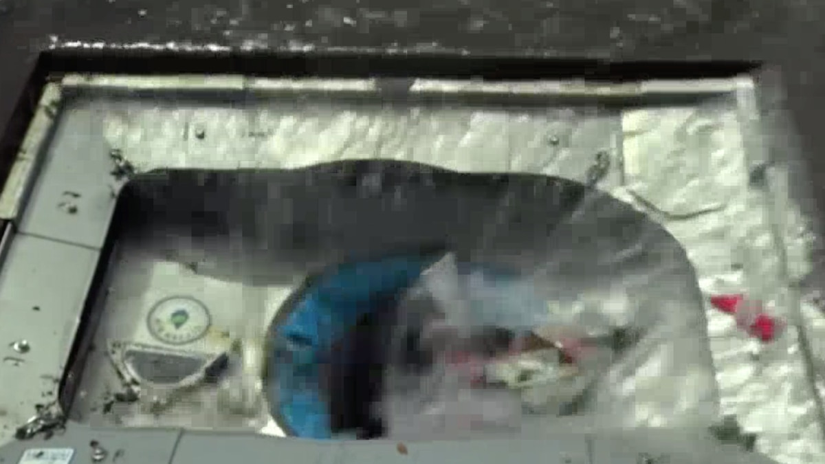 """A """"Gutter Bin"""" in a storm drain with the grate removed collecting trash in Casper, Wyo. on Thursday, May 21, 2020."""