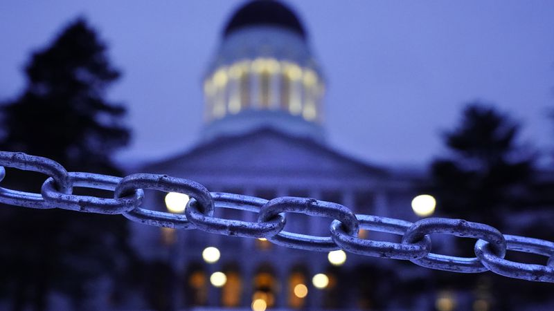 A chain blocks the sidewalk entrance to the front steps of the Maine State House, Wednesday,...