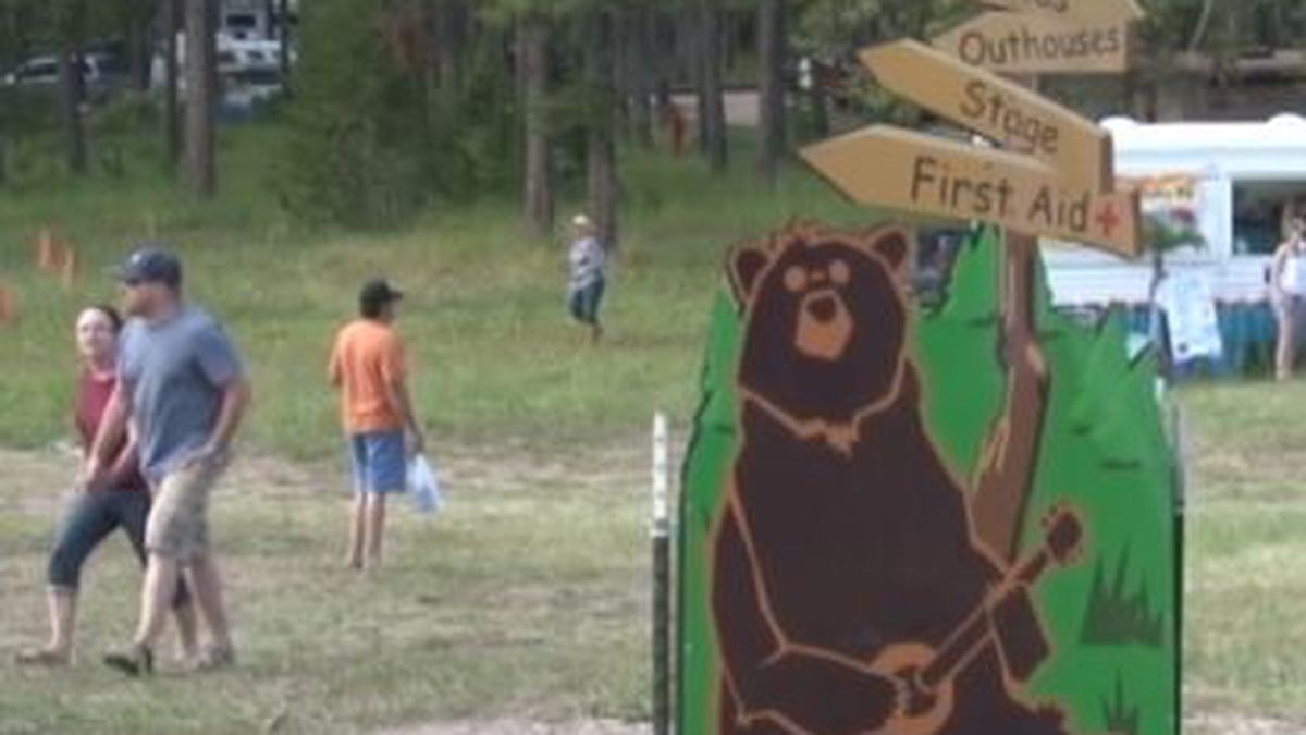 A sign directing people at 2019's Beartrap Summer Festival.