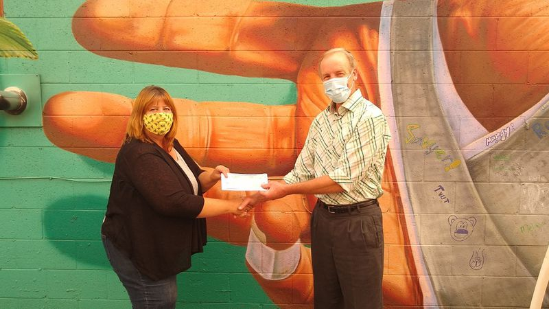 Thyra Page, Exalted Ruler, Elks Lodge 582 presents donation to Pete Gosar, Director, Downtown...