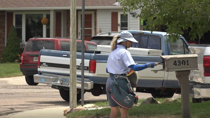USPS City Letter Carrier, Judy Drudge, on her neighborhood route Wednesday June 16, 2021.