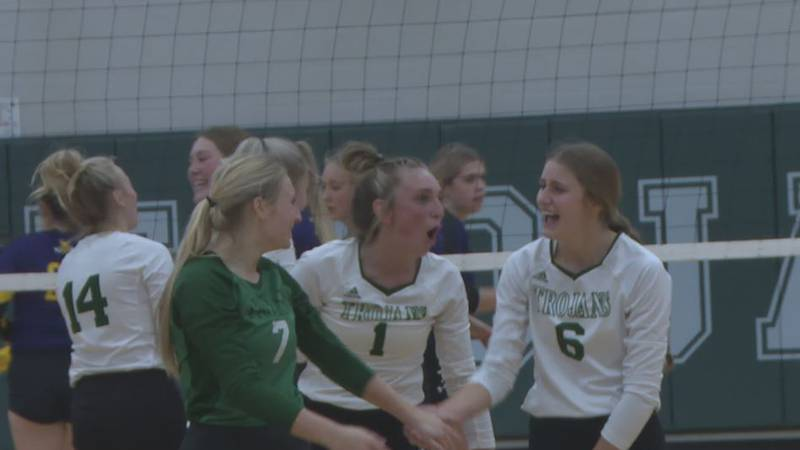 Kelly Walsh volleyball players celebrate after winning a point against Campbell County on...