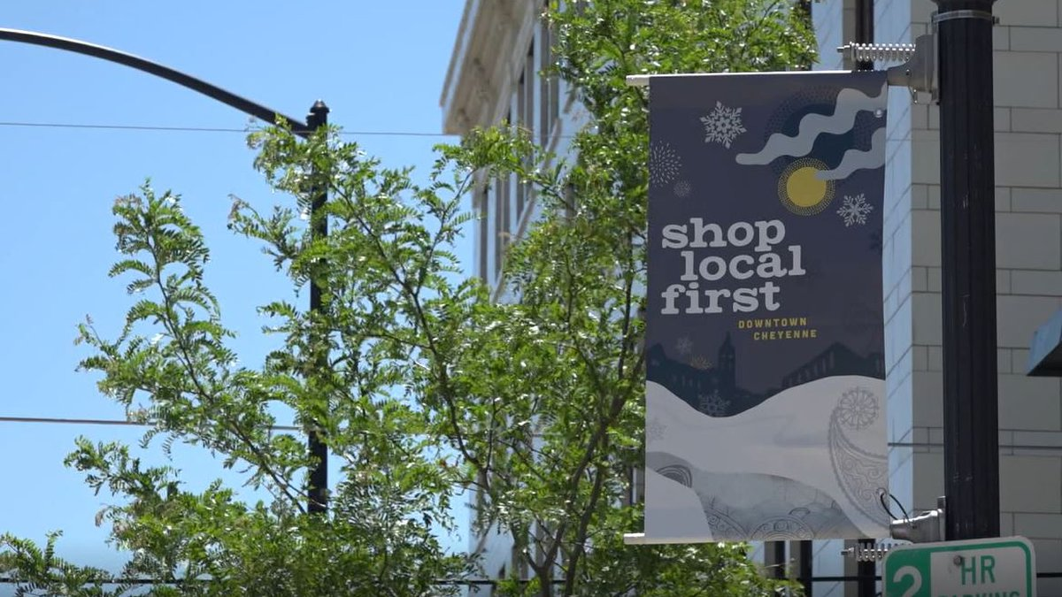 """A """"shop local first"""" sign in Downtown Cheyenne on June 11, 2021."""
