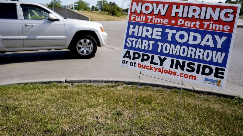 A hiring sign shows in Vernon Hills, Ill., Friday, June 11, 2021. Barely more than a year after...