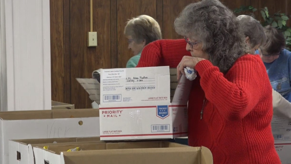 Joanne Howe puts together a package for Wyoming troops.
