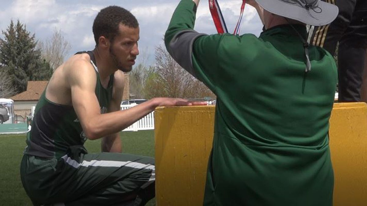 Kelly Walsh's Darius Wiggins accepts his first-place medal for the 400 m dash at the 4A East...