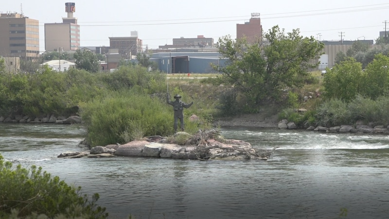 The Striking Silver statue in the North Platte River