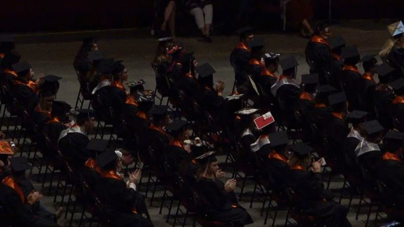 Natrona County High School seniors sit on the floor of the Ford Wyoming Center as they await to...