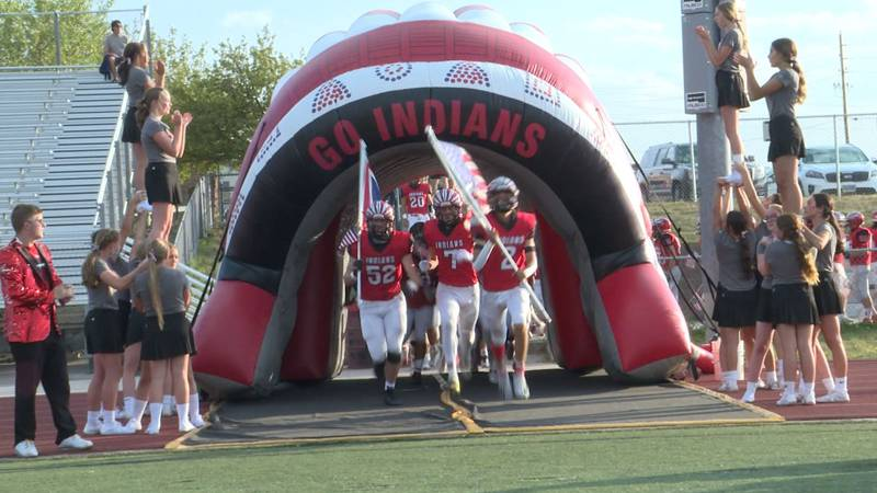 Central emerges from the tunnel before its game against Sheridan on September 10, 2021