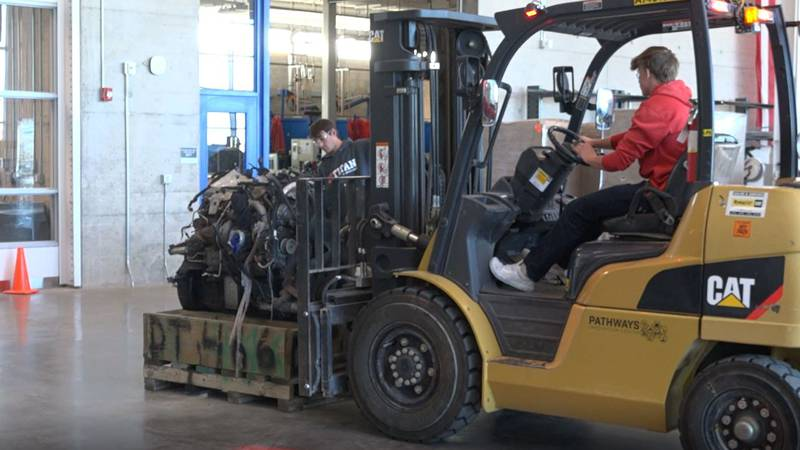 A student uses a forklift at Pathways Innovation Center