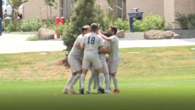 LCCC Men's Soccer celebrates around Carlos Vargas after he scores the first goal of the season...