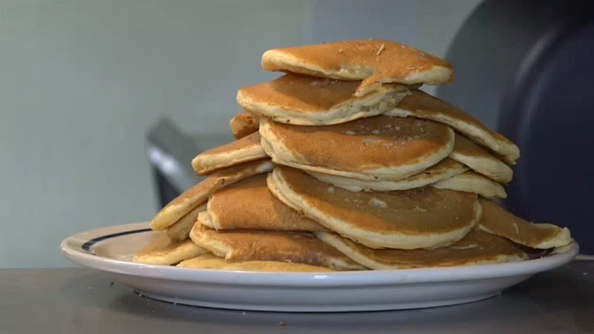 A stack of pancakes before going to a guest at IHOP.