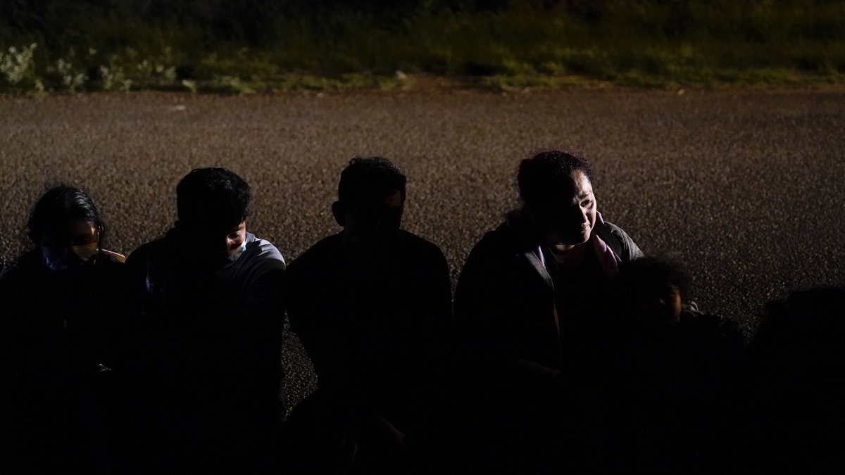 FILE - In this Monday, May 17, 2021, file photo, a group of migrants, mainly from Honduras and...