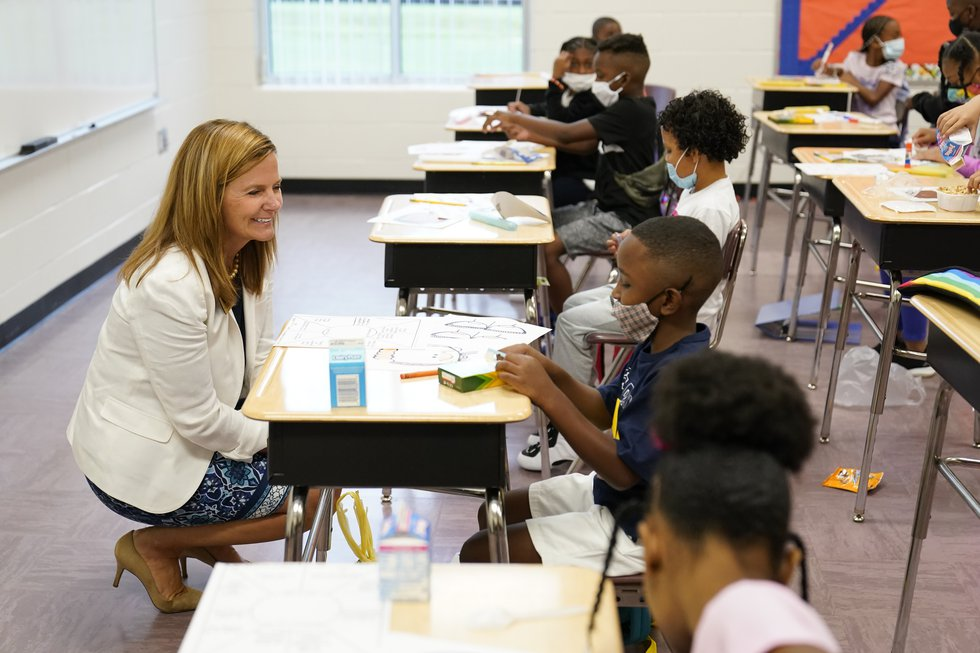 Henry County Board of Education Chair Holly Cobb, left, talks to students at Tussahaw...