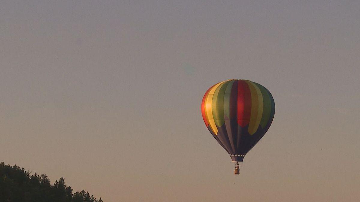 Hot air balloon soars through the sky