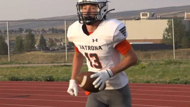 Natrona County Wide Receiver Breckin McClintock jogs back to the sideline after hauling in a...