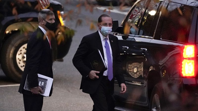 Health and Human Services Secretary Alex Azar leaves the White House Tuesday, Dec. 1, 2020, in...