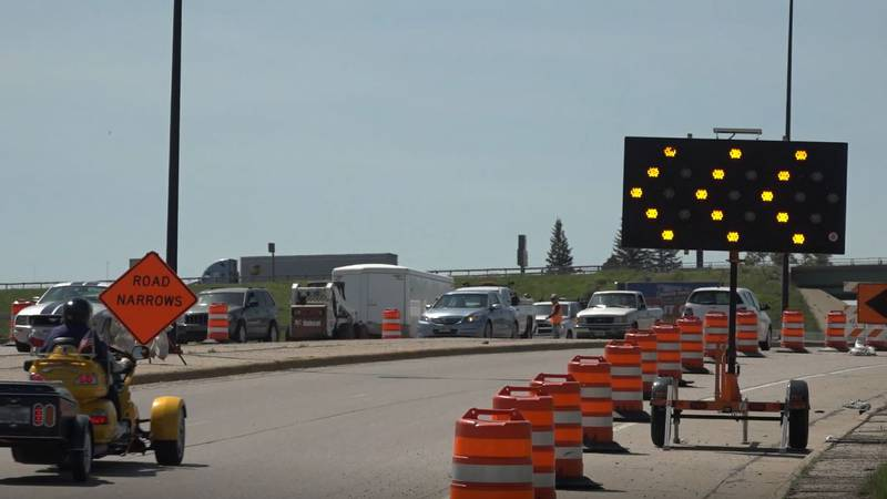 Cars drive through the South Greeley Highway construction zone on June 15, 2021.