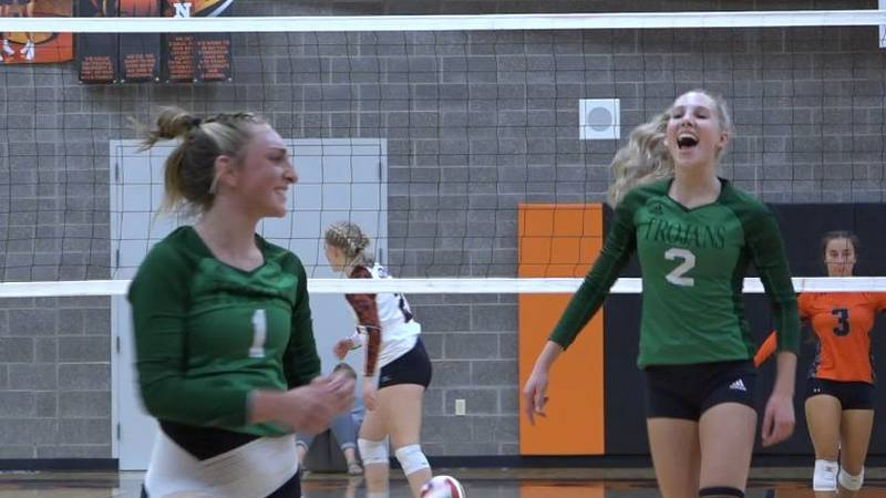 Kelly Walsh Volleyball Players Peyton Carruth and Abigail Milby smile and celebrate after...
