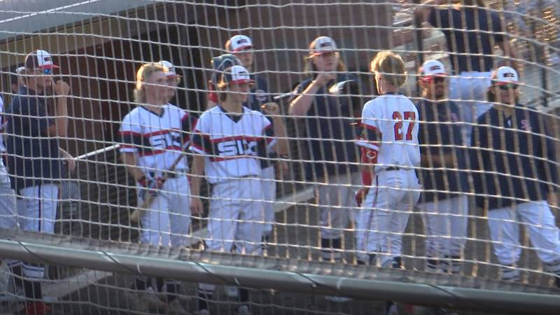 Colter McAnelly (#27) is congratulated by his teammates after clobbering a two-run home run in...