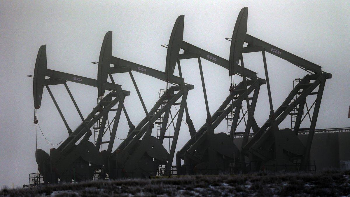 FILE - Oil pump jacks work in unison, Friday, Dec. 19, 2014, in Williston, N.D.