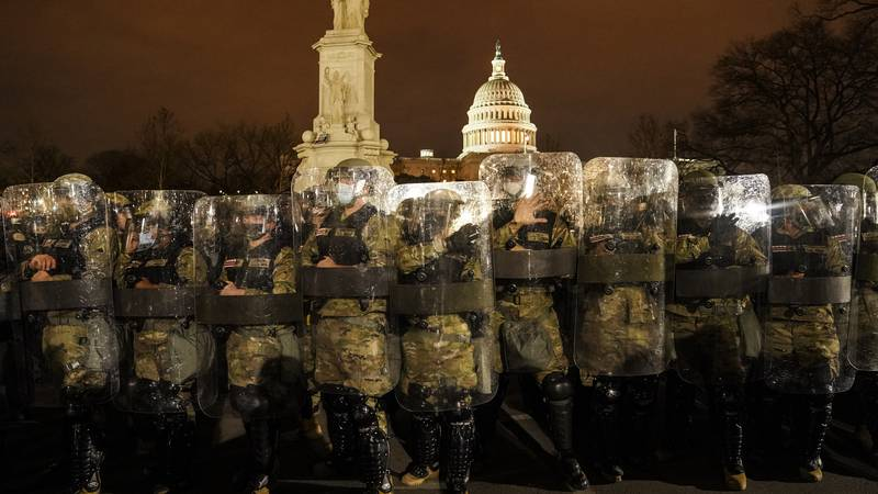 District of Columbia National Guard stand outside the Capitol, Wednesday night, Jan. 6, 2021,...