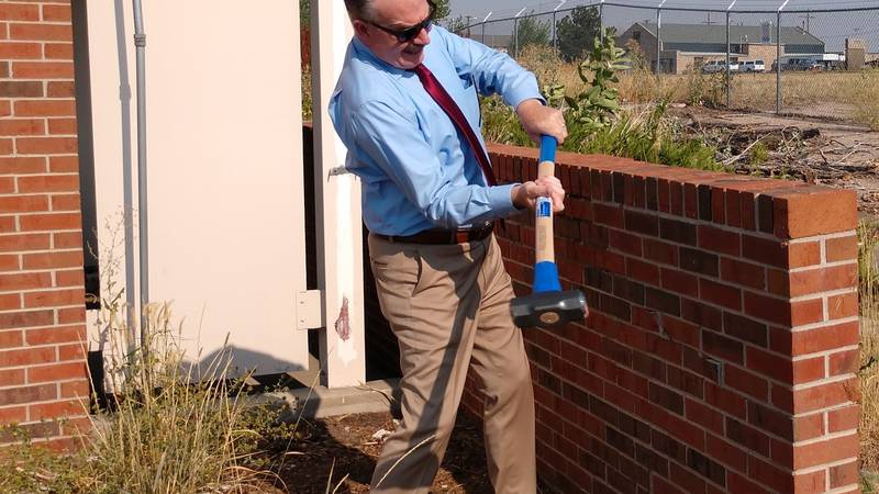 Cheyenne Mayor Patrick Collins takes the first swing at a Brick Breaking last week at the...