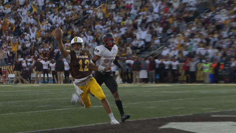 Wyoming Cowboys quarterback, Sean Chambers, runs for a touchdown in the Cowboys 53-17 win...