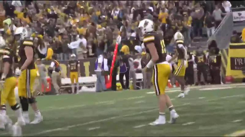 University of Wyoming's Levi Williams lines up for his first snap at quarterback during the...