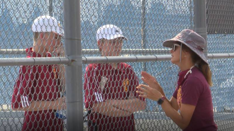 Two Laramie tennis players get coached up during the Plainsmen's 5-0 win over Cheyenne East on...
