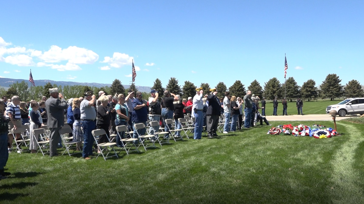Community members gather to remember the fallen on May 31