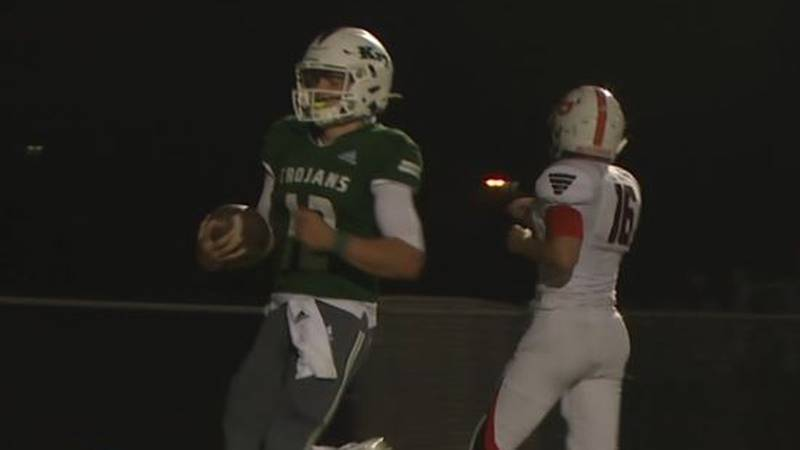 Former Kelly Walsh Quarterback Trent Walker jogs into the end zone after scoring a touchdown in...