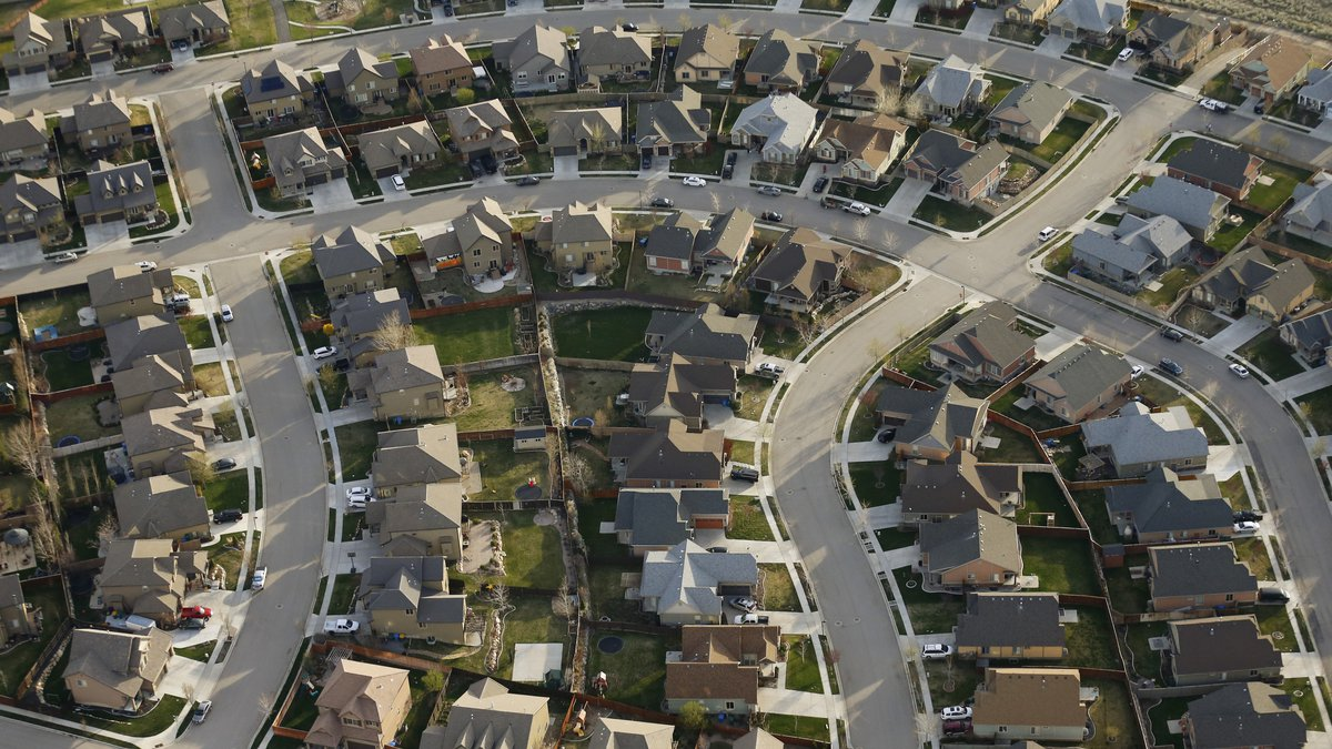 This April 13, 2019, file photo, shows homes in suburban Salt Lake City.  Two studies released...