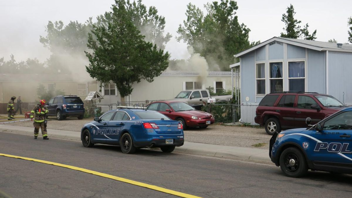 Structural fire of single wide/modular home with heavy smoke exiting.