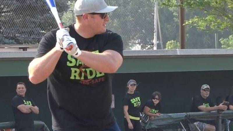 Mills Fire Captain Jeremy Todd loads up at the plate during the Natrona County First Responder...