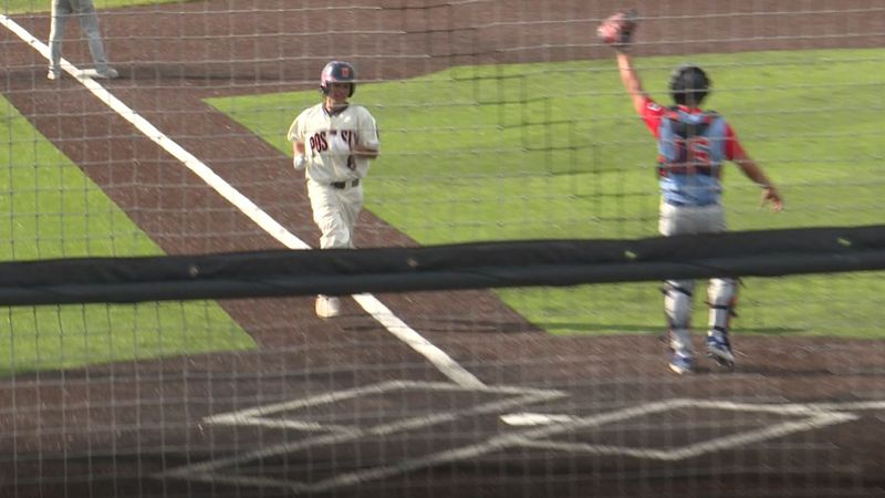 Julian Romero gets ready to cross the plate in Cheyenne Post 6's 9-5 Game 1 victory over...