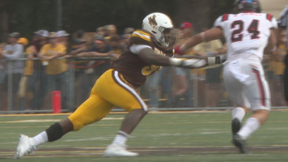 University of Wyoming Defensive End Jaylen Pate dives to make a tackle against Ball State on...