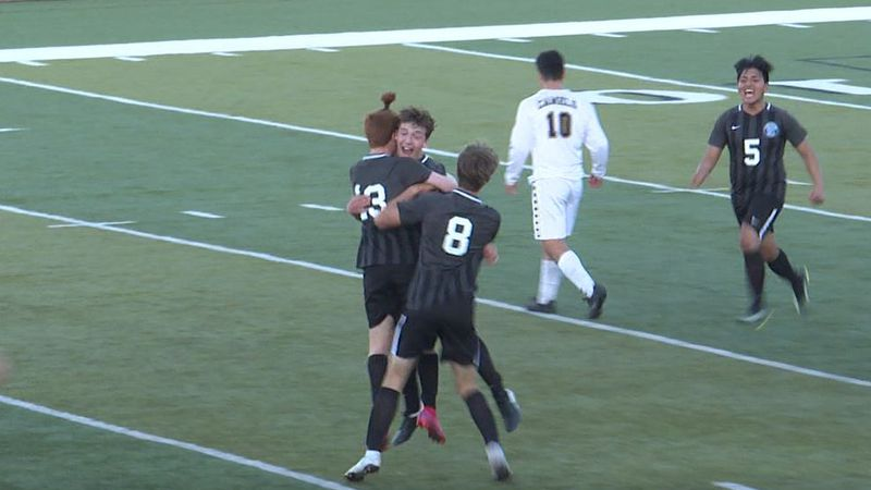 Sid Cashin, Isaac Rich (#13), and Chase White (#8) celebrate after Cashin's game-tying goal...