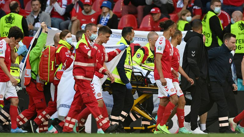 Denmark's Christian Eriksen is taken away on a stretcher after collapsing on the pitch during...