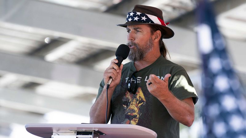 FILE - Alan Hostetter speaks during a pro-Trump election integrity rally he organized at the...