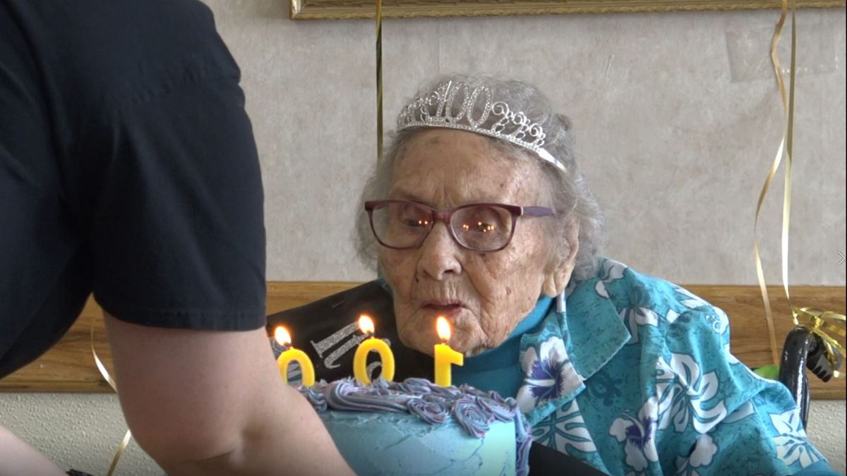 Rose Harris blows out her birthday candles at Morning Star Care Center in Fort Washakie.