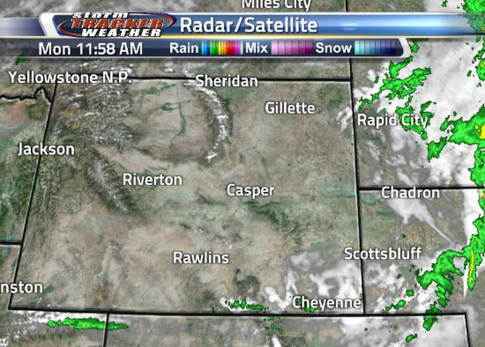 A system of rain and clouds pushed through, it is now leaving scattered showers and clouds...