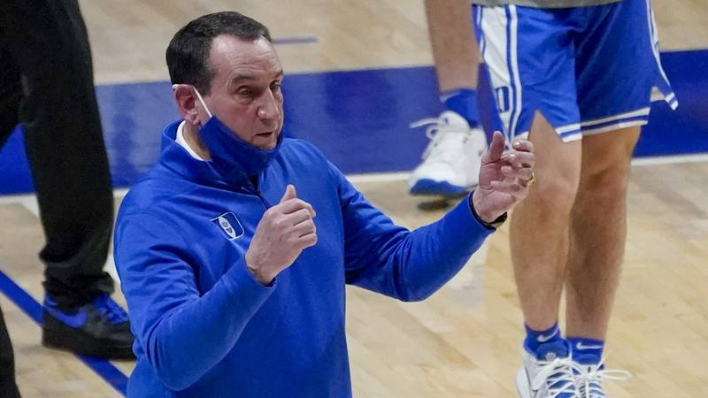 Duke head coach Mike Krzyzewski calls to his team during a timeout against Pittsburgh during...