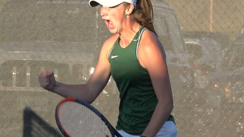 Kelly Walsh's Finley Klinger celebrates after securing a set victory during a match against...