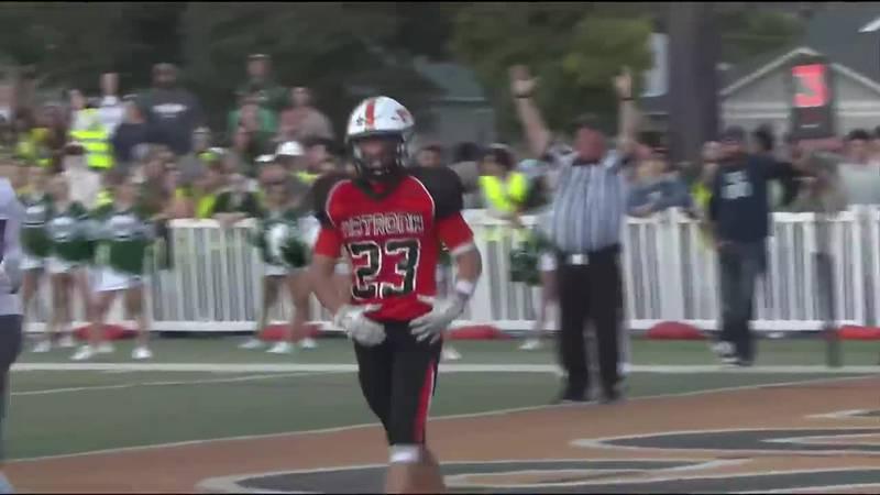 Natrona County Running Back Kaeden Wilcox flexes after scoring a touchdown before heading into...